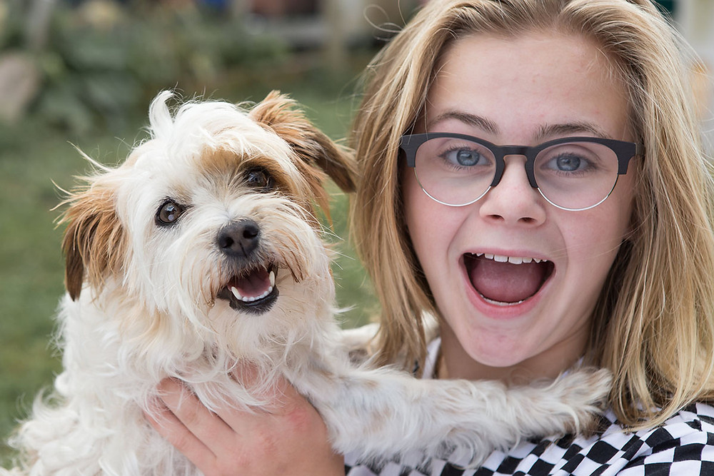 Great expression from girl and dog in this family picture