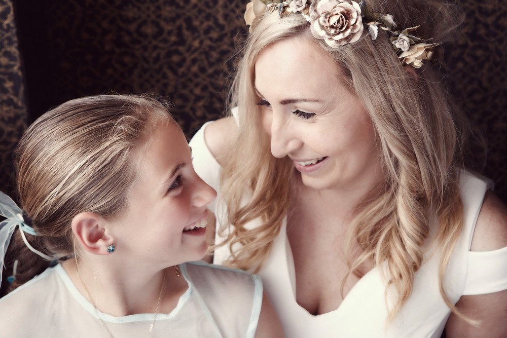 A bride and her niece share a moment during their wedding reception in Careys Bay Hotel, Dunedin