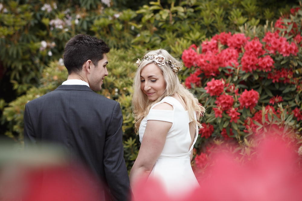 Bride and groom share a quiet moment after their wedding ceremony at the Rhododendron Dell in Port Chalmers