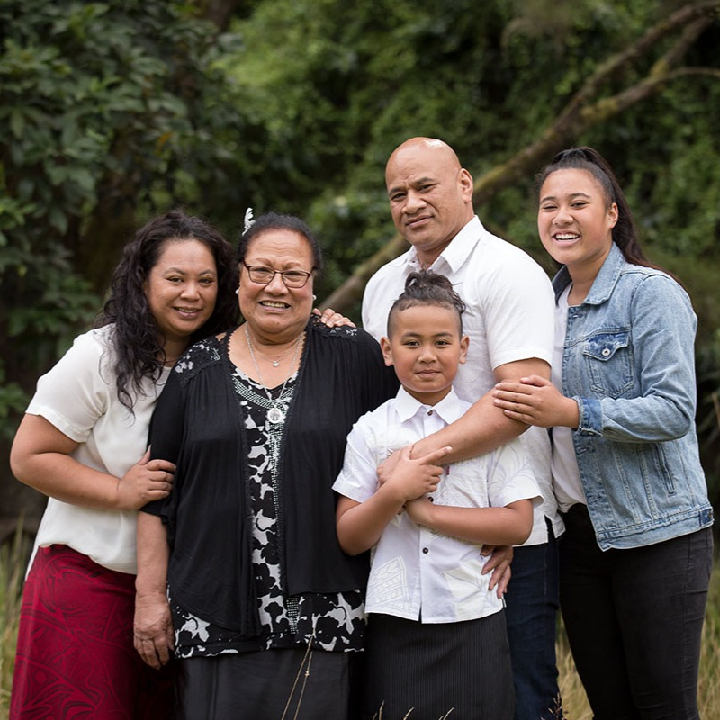 Three generations pose together for a family portrait in Dunedin