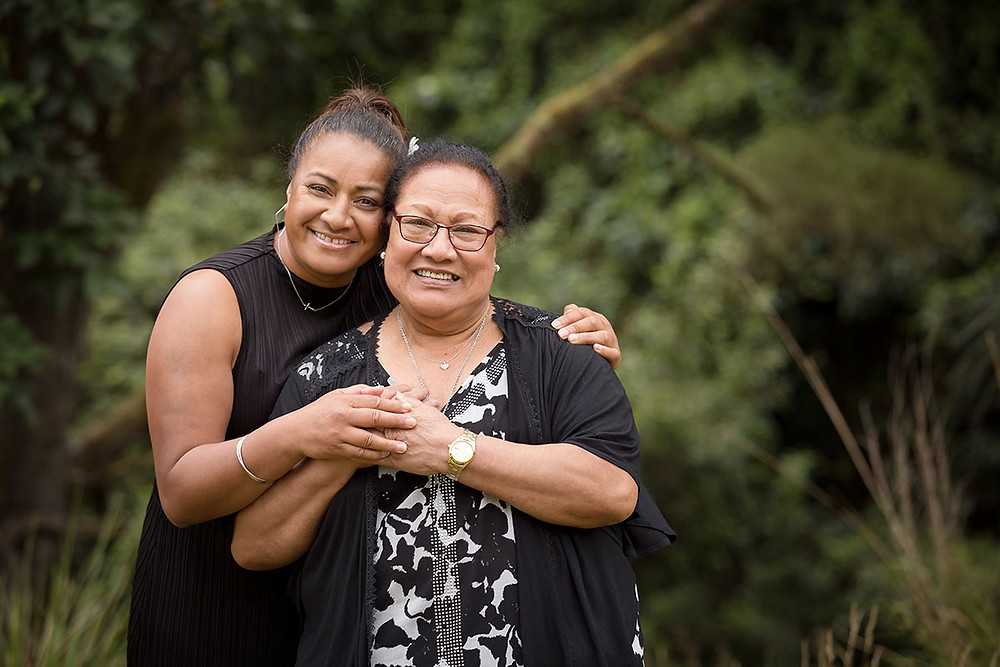 Grandma and daughter pose together for a portrait during a multi-generation family photoshoot in Dunedin.