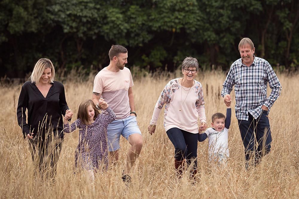 Family portrait shot in long grass at a location in Mosgiel, Dunedin, NZ