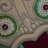 embroidered pillow close up.jpg
