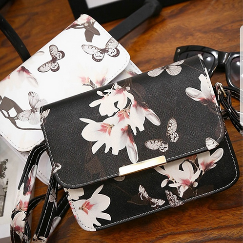BFLY.  Small White Butterfly detailed satchel bag with magnetic closure