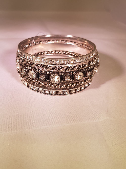 RSAC.  Vintage style Diamontie detailed silver plated 5 piece Bangle set.
