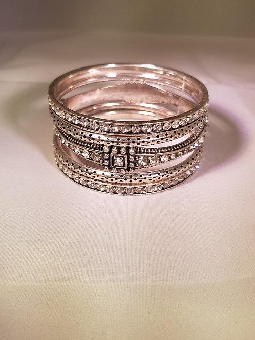 RASD.  Vintage style Diamontie, blocked detailed silver plated 5 piece bangle