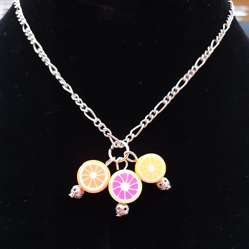 Funky handmade citrus fruit pendant and necklace.