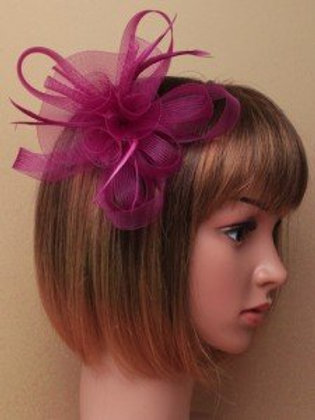 6449.  Purple looped net centre rosette and feather fascinator