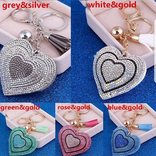 01061.  Silver or gold plated heart bag/key charm