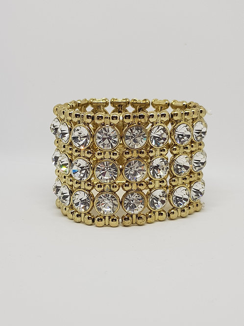GCB.  Gold and Diamontie Elasticated 3 row bracelet.