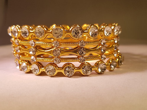 RASG.  Diamontie, block & wavey detailed gold plated 3 piece Bangle set.