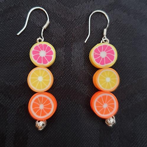 Stylish handmade citrus fruit earrings.
