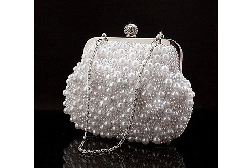 1734.  Pearl mini hasp Closure clutch bag.