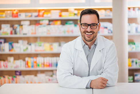 Smiling portrait of a handsome pharmacis