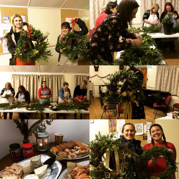 Attendees at a Christmas wreath making workshop