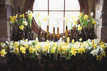 Wedding reception table flowers and venue dressing created by using a DIY spring flower bucket