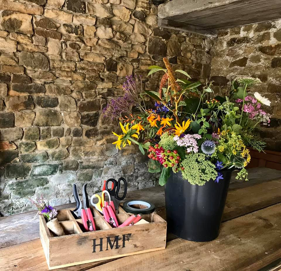 The cutting barn, tools and flowers all ready for the attendees arrival