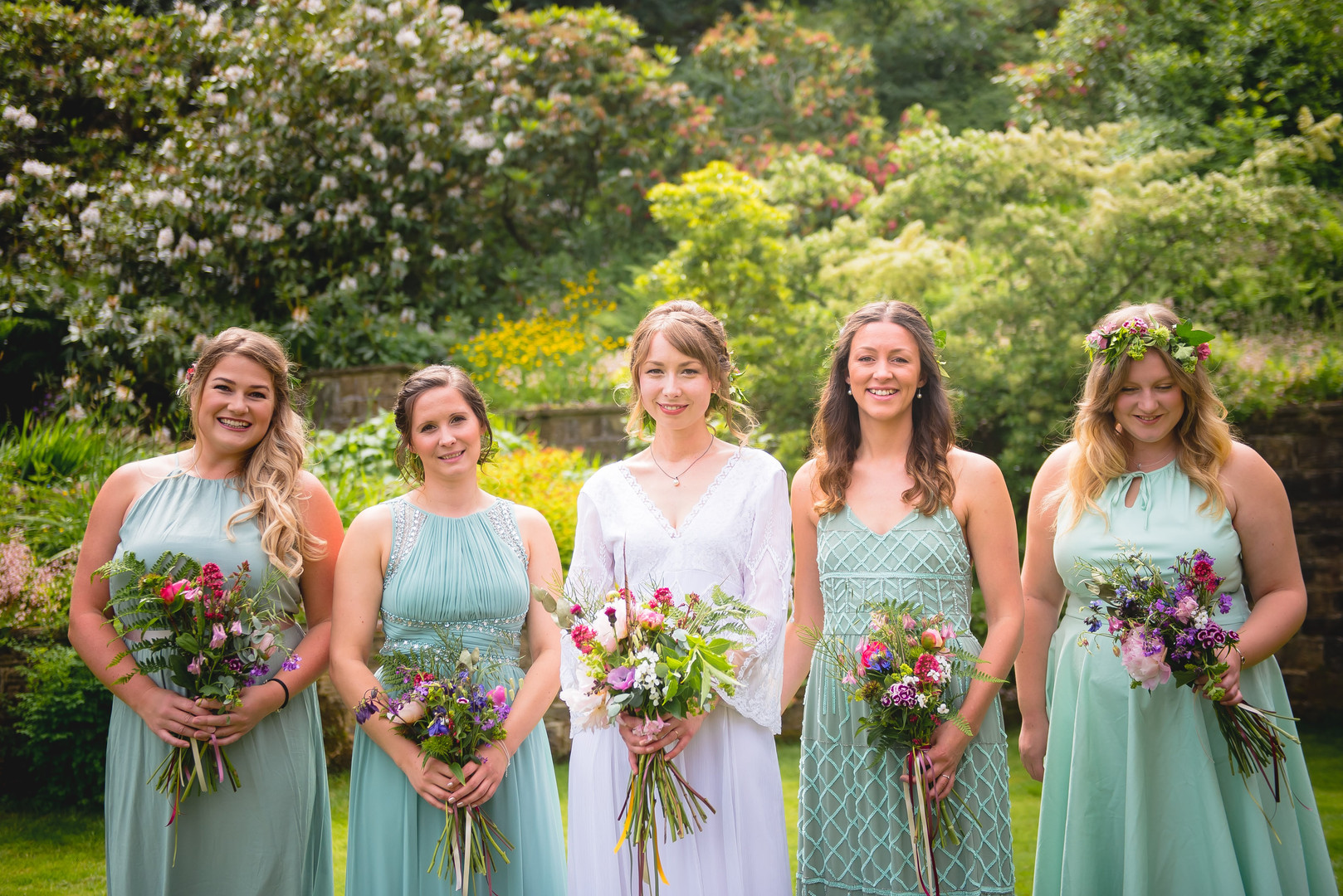 Handtied bridal and bridesmaids bouquets using locally grown flowers by Hollow Meadows Flowers, Sheffield and the Peak District. Photo - Kate Cooper Photography