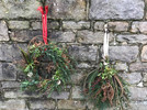 Christmas wreaths and decorations made by attendees at a Hollow Meadows Flowers workshop