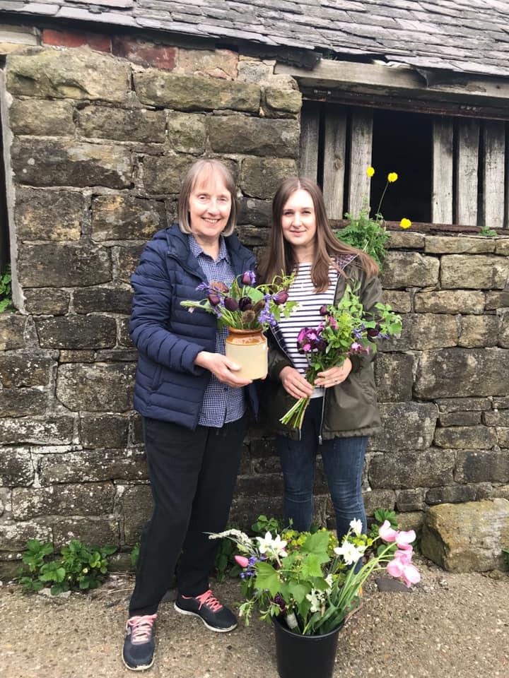 Mother and daughter attending a cut flower arranging workshop