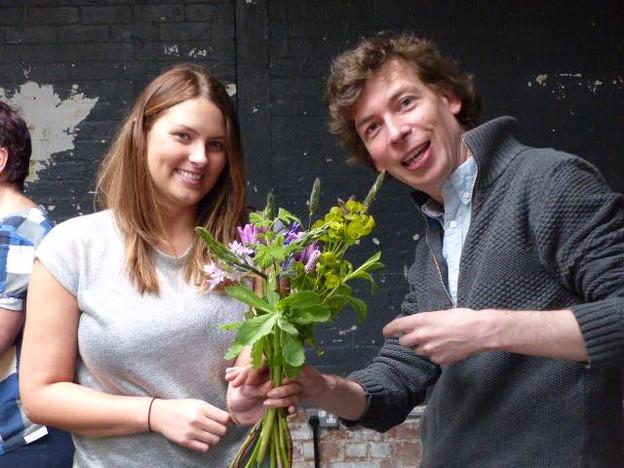 Workshop attendees enjoying a cut flower arranging workshop