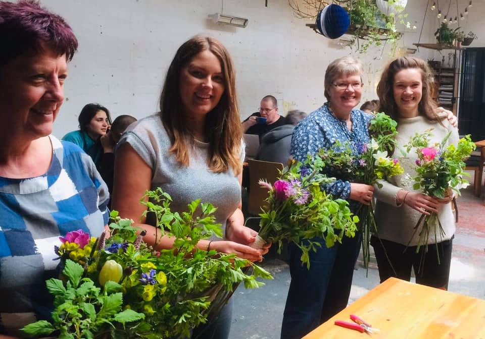 Attendees with their cut flower arrangements made during the workshop