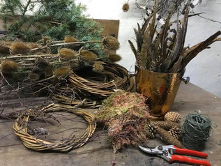 A christmas wreath making workshop set up ready for attendees
