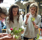 Attendees working on their arrangements using cut flowers