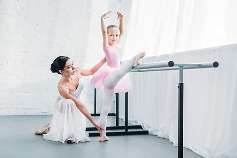 adorable-child-in-pink-tutu-stretching-a