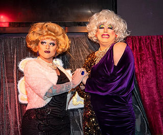 Two drag queens performing