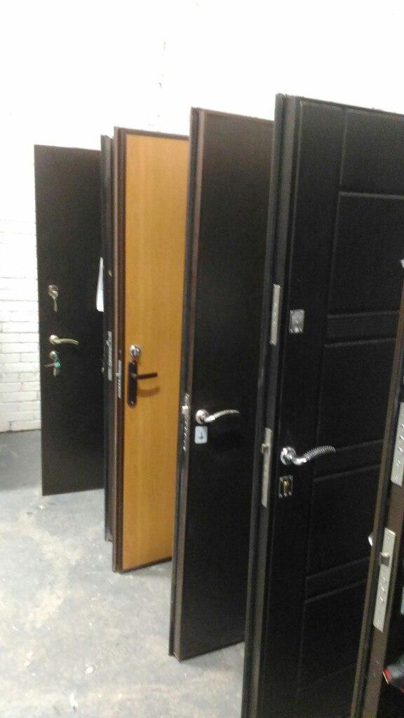 Двери в квартиру с панелями мдф