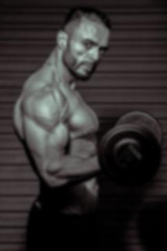 adult-athlete-biceps-1483217.jpg