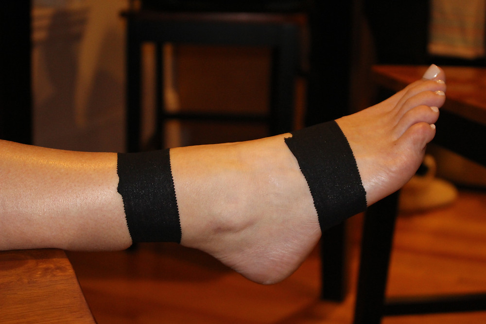 foot with black athletic tape