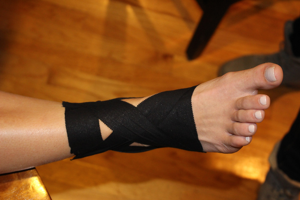 foot with athletic tape