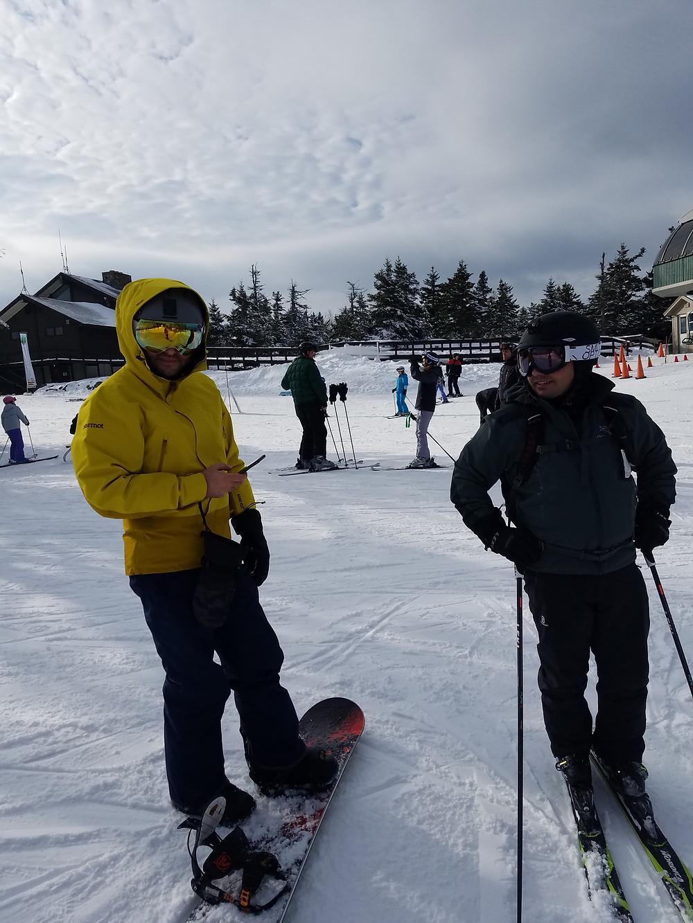 Skier and snowboarder at Sunapee