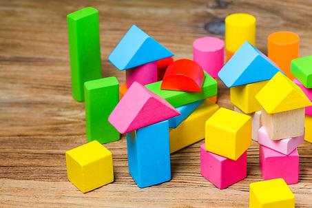 building-blocks-wooden-background-colorful-wooden-building-blocks.jpg