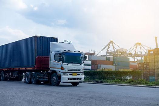 container-blue-truck-ship-port-logistics