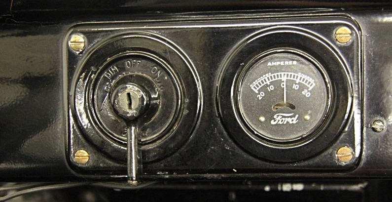 The instrument panel from a 1924 Ford Model T Roadster only included an amp meter, no speedometer, no fuel, oil, or temperature gauges.