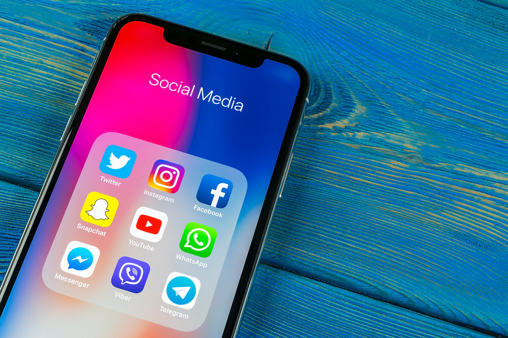Social Media platforms for 2020. iPhone with social media platforms.