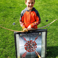 Mason, 6, with his hickory/antler longbow made by Grandpa