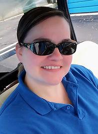 Tina on golf cart.jpg