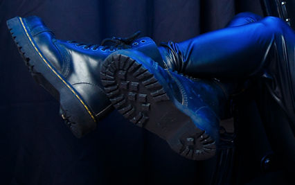 Dr. Marten Boots in blue light, displaying the profile view and bottoms of soles. Shot by 2G Photography