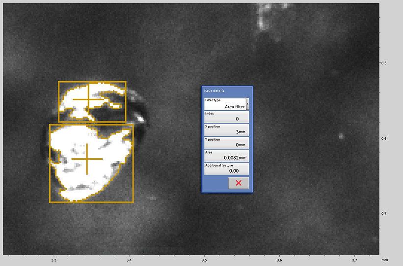 Zoom auf ein einzelnes Klebstoff Tröpfchen mit Flächenberechnung durch Bilderkennung. Anwendung Digitales Mikroskop von Fa. Robomat