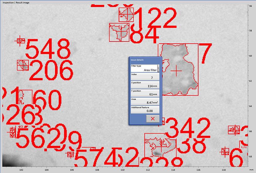 Zoom auf Kalkflecken mit Flächenberechnung und größenabhängiger Nummerierung durch die Bilderkennung. Anwendung des Flächen Mikroskops von Robomat.eu