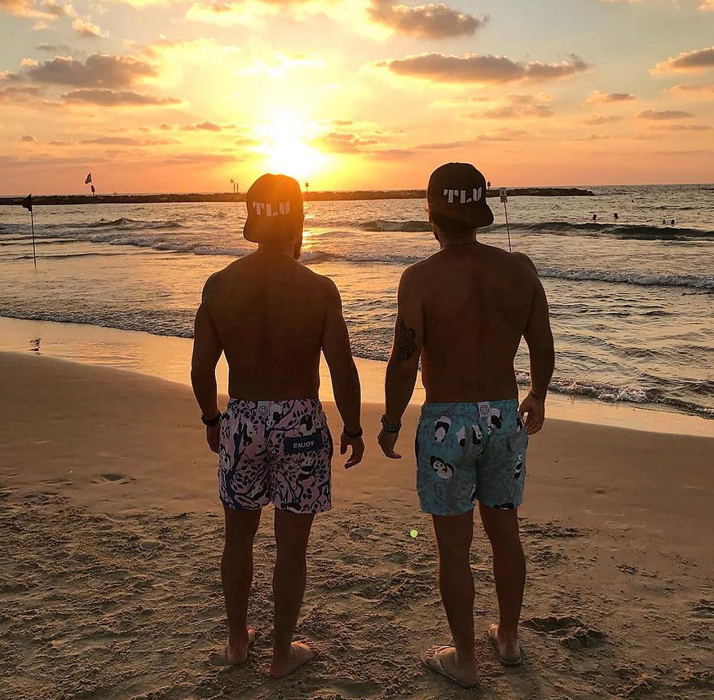 Oleh Johnny Denver Levine  and a friend watching the sunset on the beach in Tel Aviv