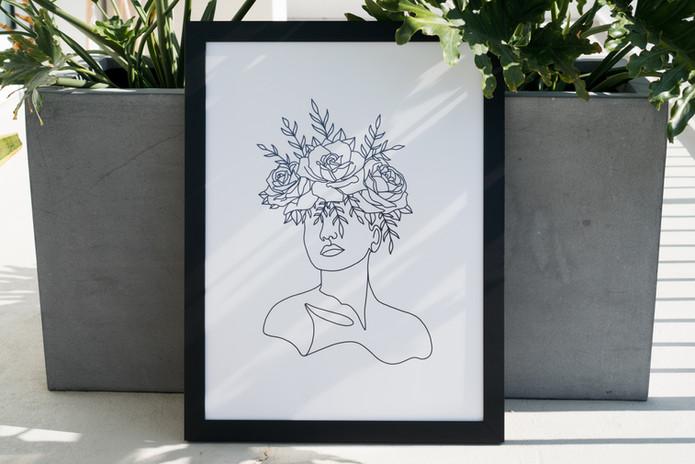 Girl in Bloom Framed Print