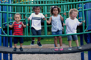 A diverse group of four children are pla