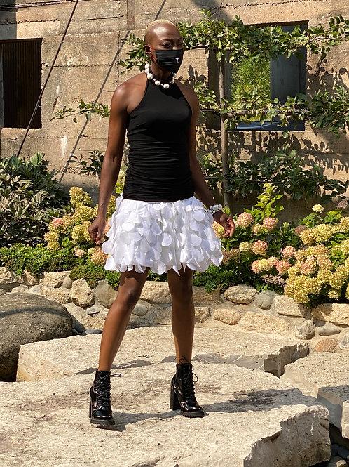 White Neoprene and Laser-cut petal skirt.