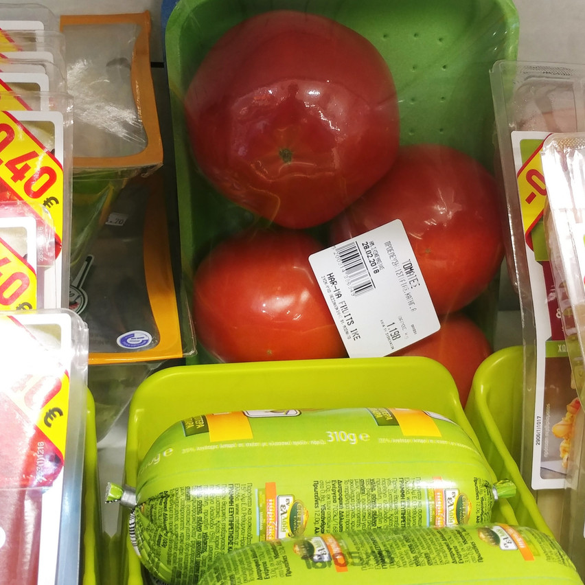 Packages tomatoes and... something