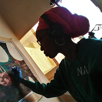 Nia Alexander painting in Doha, Qatar